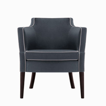 Brizio dark blue tub chair with wooden tapered legs and contrasting piping