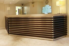 University Reception - grooved-wooden-reception-desk