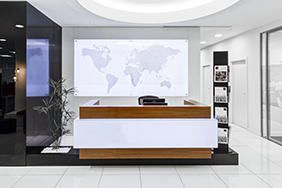 University Reception - white-and-walnut-wood-reception-desk