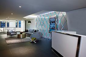 University Reception - white-reception-desk-with-metal-trim