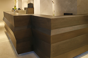 University Reception - dark-wood-reception-desk