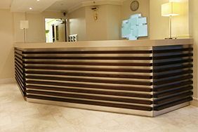 University Reception - grooved-wooden-reception-desk