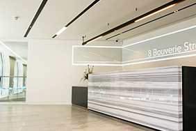 University Reception - marble-and-wood-reception-desk