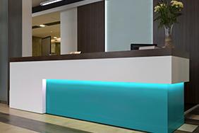 University Reception - teal-underlit-reception-desk